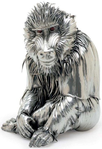 A SILVER FIGURE OF A MANDRILL