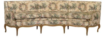 A LOUIS XV STYLE BEECH CURVED
