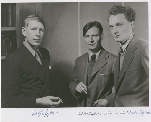 """AUDEN, Wystan H. (1907-1973). Poet. Large photograph signed (""""Wystan Auden""""), also signed by CHRISTOPHER ISHERWOOD (""""Christopher Isherwood"""") and STEPHEN SPENDER (""""Stephen Spender""""). [Photo by Howard Coster (1885-1959), 1937.] 8 x 10¼ in., with margins. FINE. Signed by all three in ink in lower margin. Auden stands at far left in a double-breasted pinstripe suit and tie, holding a cigarette in his right hand. Isherwood stands at center, with Spender at far right."""