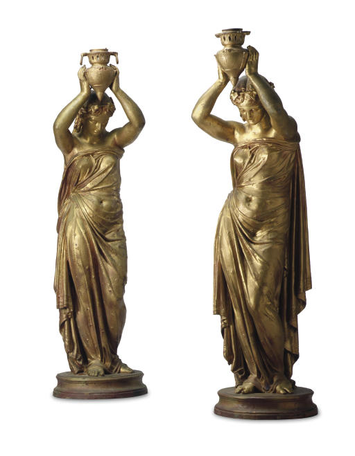 A PAIR OF FRENCH GOLD-PAINTED CAST-IRON FIGURAL TORCHERES
