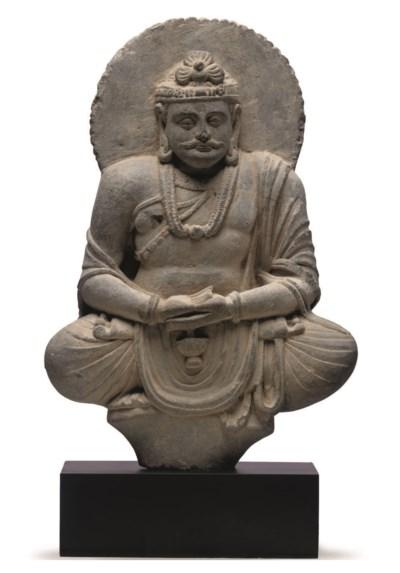 A gray schist figure of Maitre
