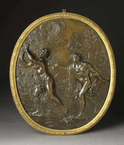 A PATINATED-BRONZE RELIEF PLAQ