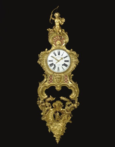 A REGENCE ORMOLU AND BRASS-INL