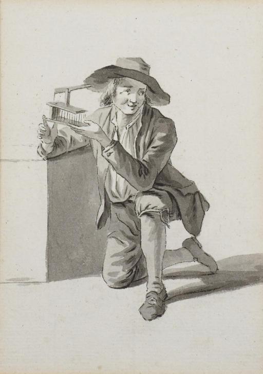 Jeune garçon agenouillé tenant une cage dans les mains