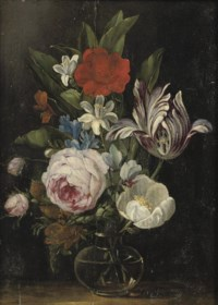 Roses, a tulip and other flowers in a glass vase
