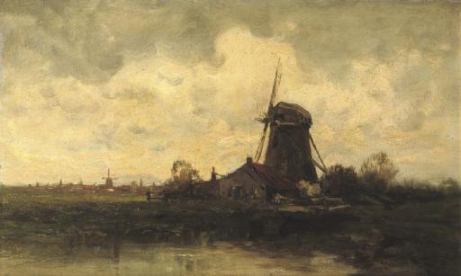 A windmill along a river