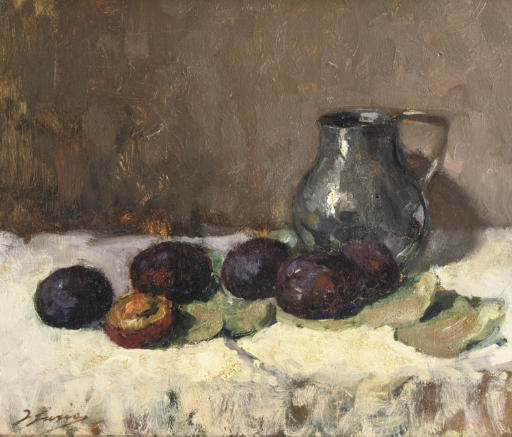 Prunes and a jug on a table