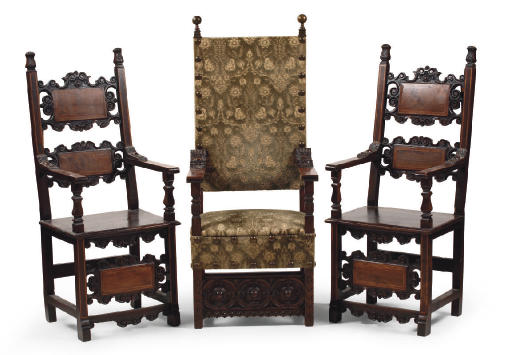A PAIR OF AUSTRIAN WALNUT AND STAINED WALNUT HIGH-BACK ARMCHAIRS