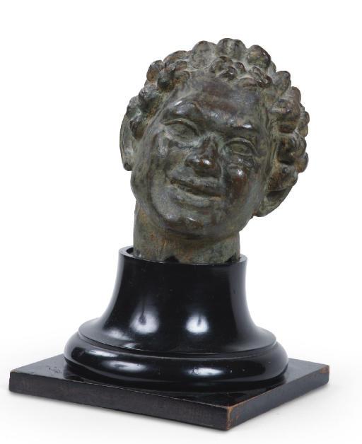A BRONZE HEAD OF A FAUN