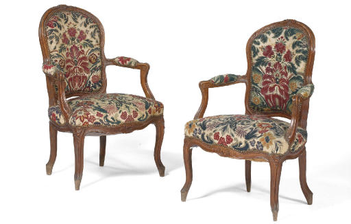A PAIR OF LOUIS XV CARVED BEEC