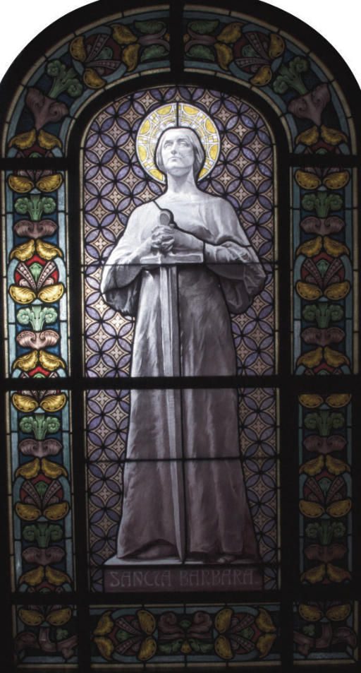 AN AUSTRIAN STAINED-GLASS WINDOW PANEL DEPICTING ST. BARBARA