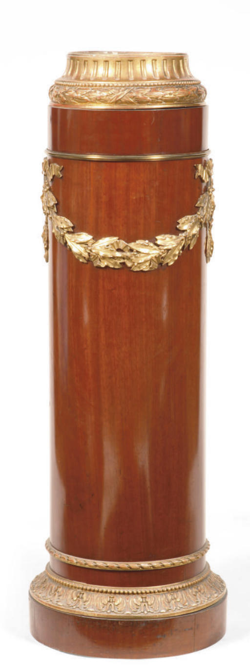 AN AUSTRIAN GILT-METAL MOUNTED, CARVED GILTWOOD AND MAHOGANY PEDESTAL