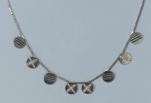 A NECKLACE MADE OF DRESS BUTTO