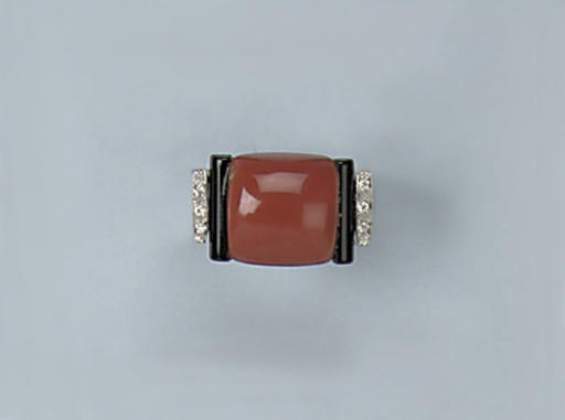 A CORAL, ONYX AND DIAMOND RING