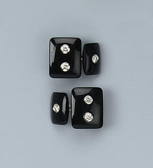 A PAIR OF ONYX AND DIAMOND CUF