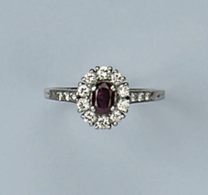 A RUBY AND DIAMOND RING, BY TI
