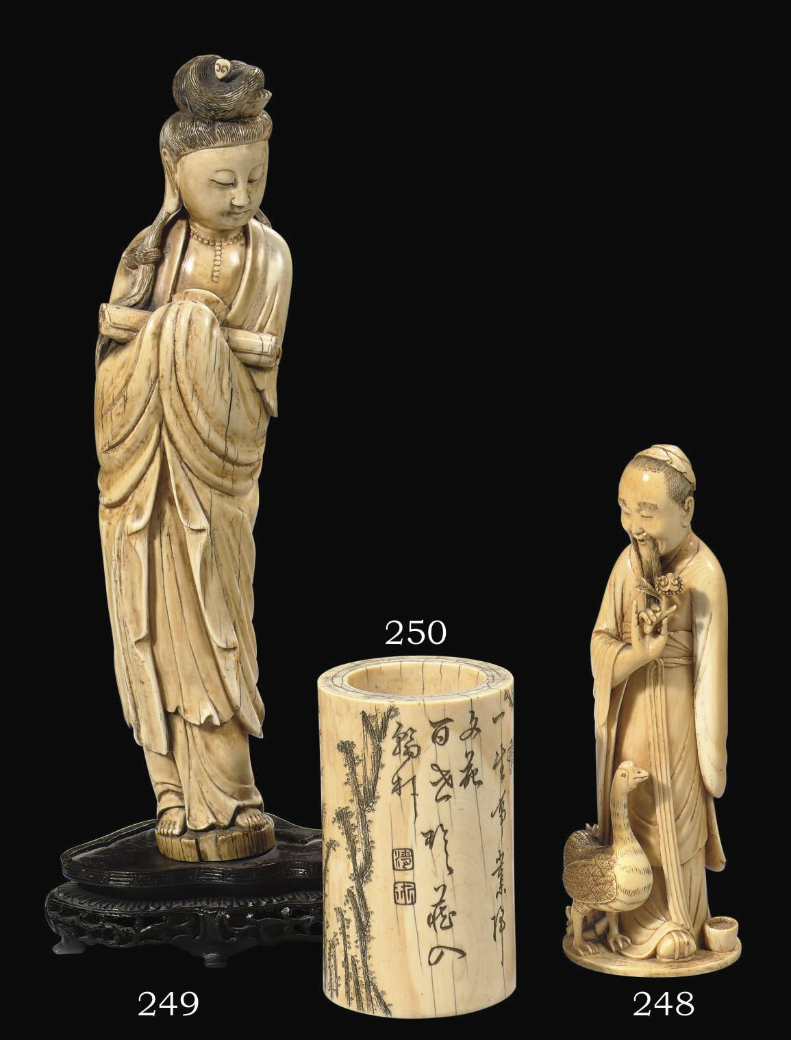 An ivory figure of a scholar