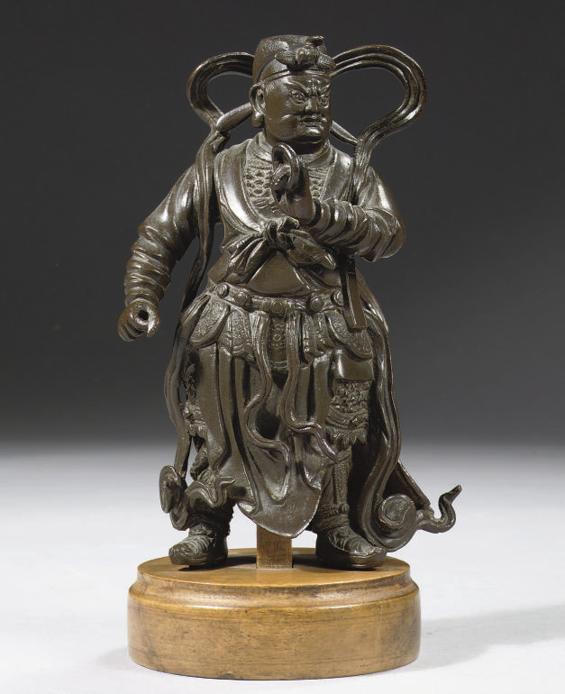 A chinese bronze figure of a g