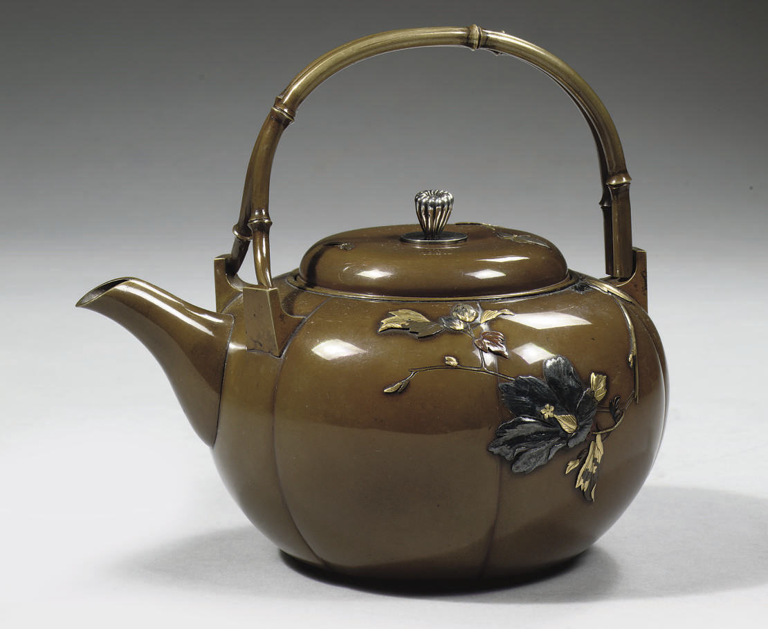 A bronze teapot and cover