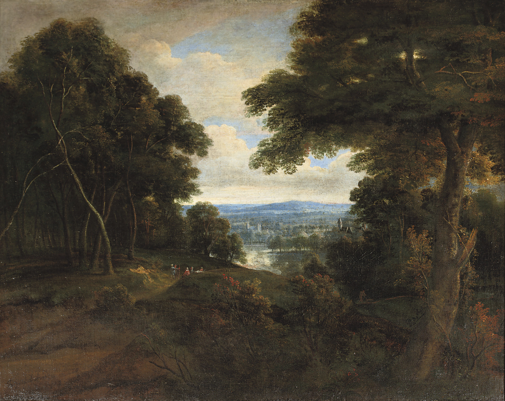 An extensive wooded landscape with travellers on a path