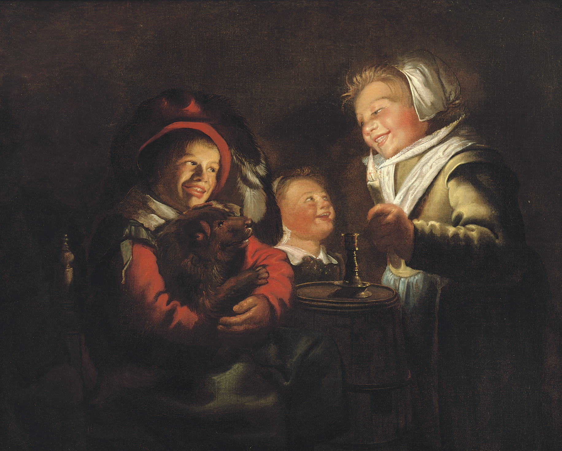 Two girls and a boy with a dog by candle light
