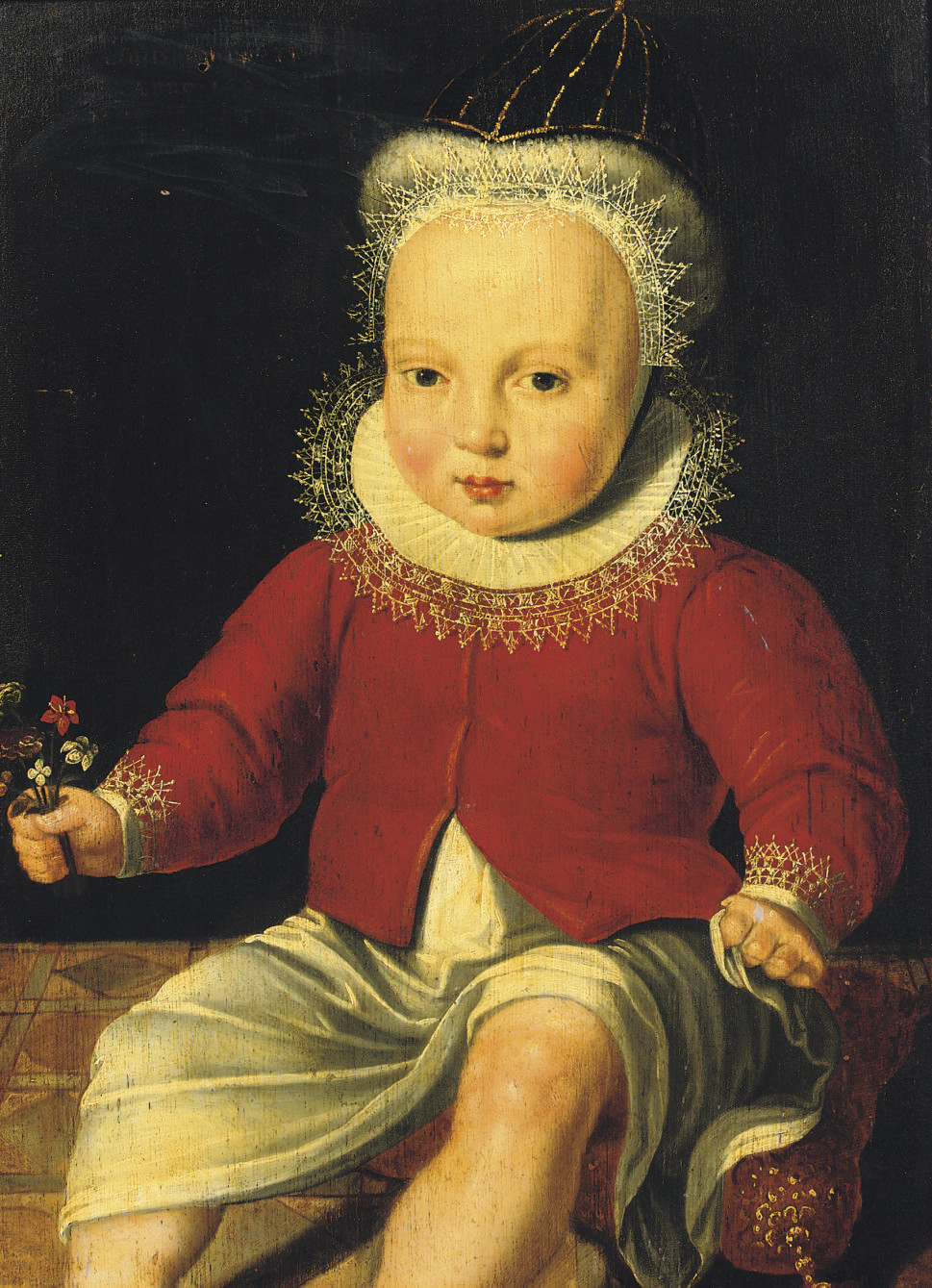 Portrait of a child, three-quarter-length, in a white dress and a red coat, seated on a pillow, holding a bunch of flowers