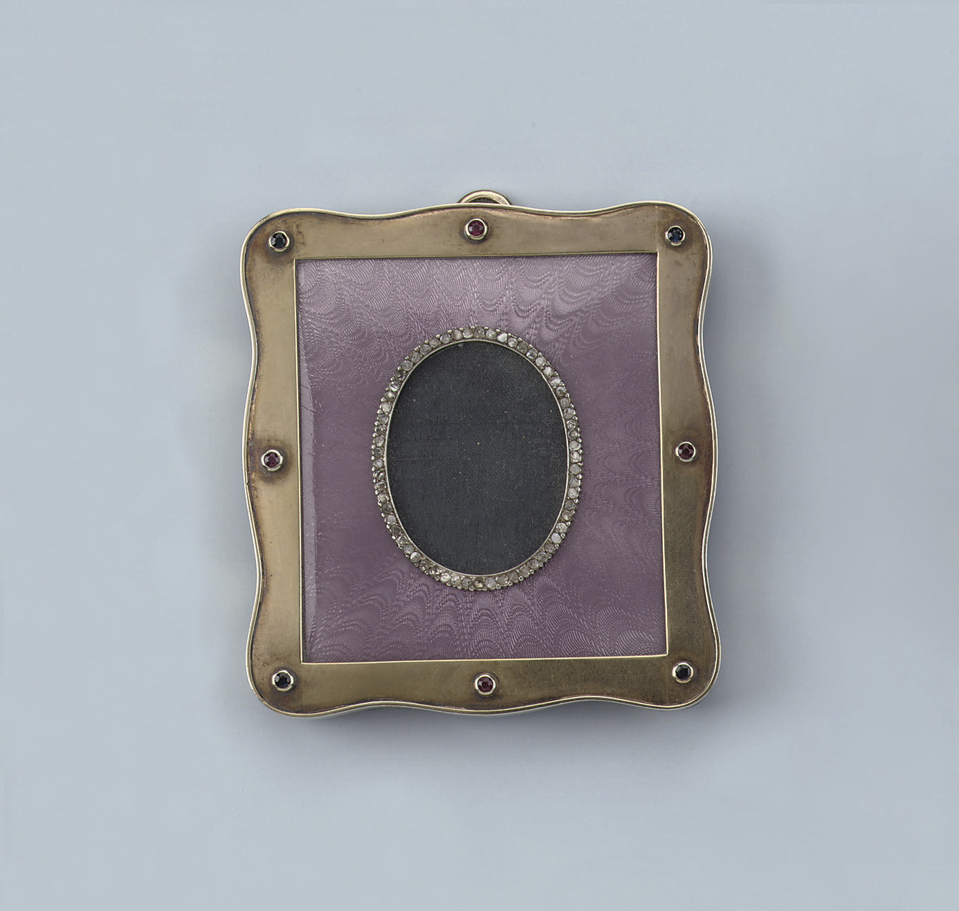 A RUSSIAN ENAMEL AND DIAMOND PHOTO FRAME