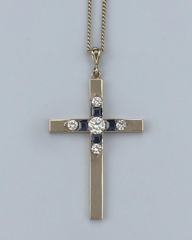 A SAPPHIRE AND DIAMOND CROSS P