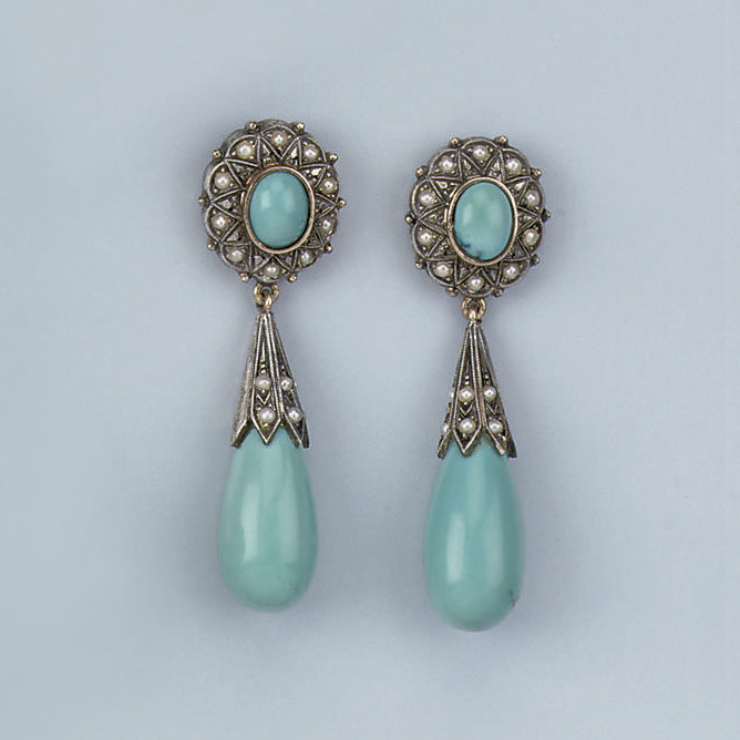 A PAIR OF TURQUOISE AND HALF PEARL EARRINGS