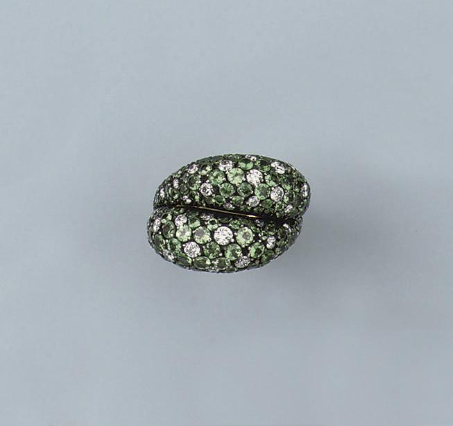 A TSAVORITE AND DIAMOND RING