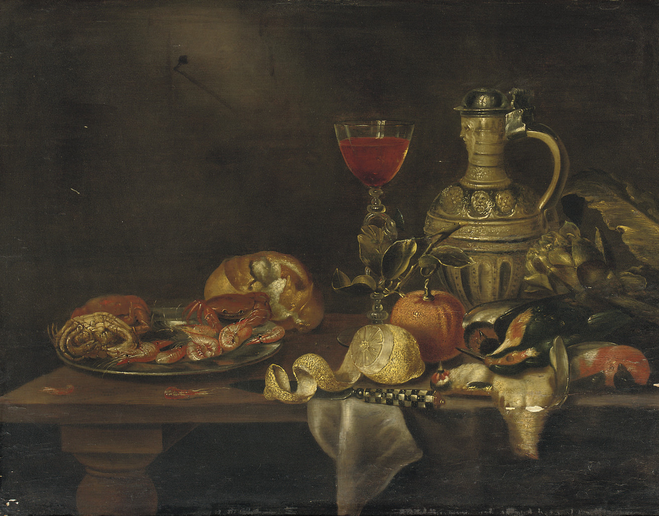 A silver plate with seafood, a roll of bread, a 'Façon-de-Venise of red wine', a 'keulse pot', an artichoke, dead birds, an orange, a partially pealed lemon and a knife