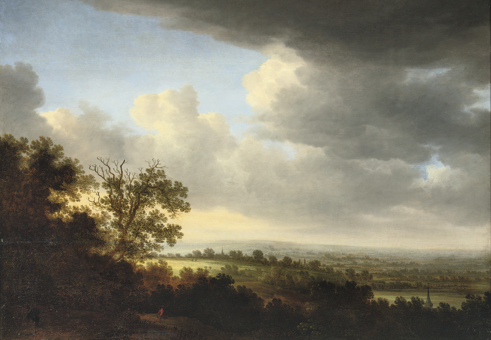 An extensive wooded landscape with figures