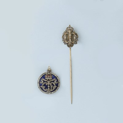 AN ENAMEL AND DIAMOND PENDANT