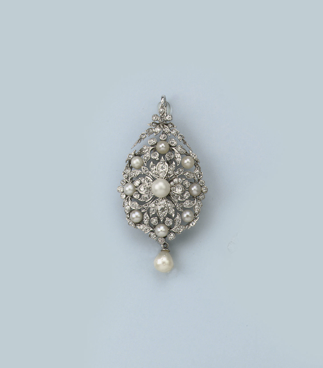 A CULTURED PEARL AND DIAMOND B