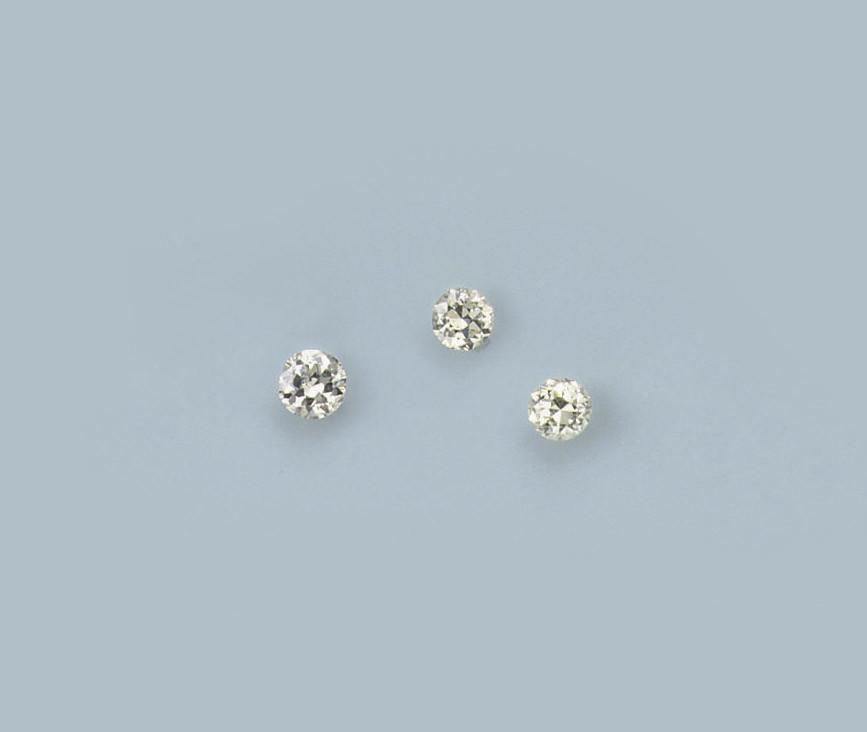 THREE UNMOUNTED DIAMONDS