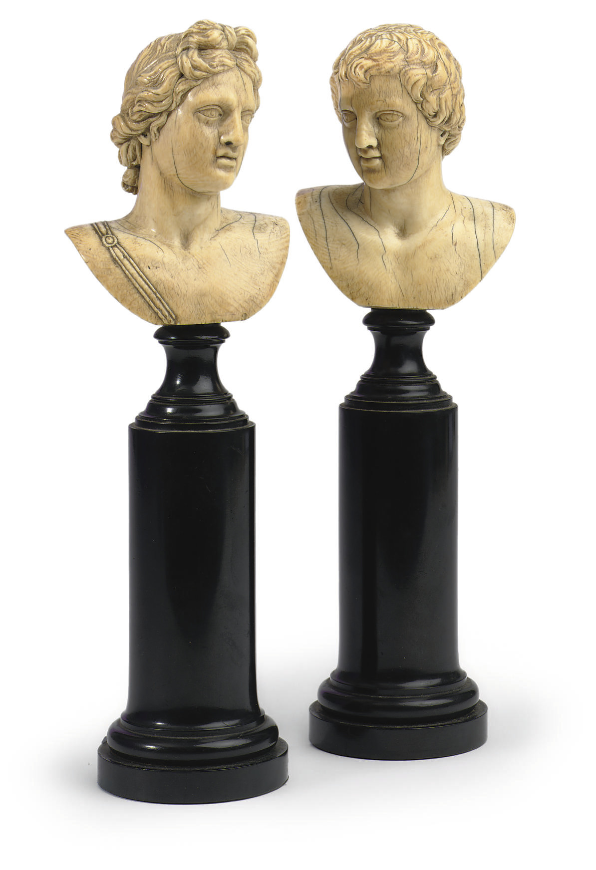 A PAIR OF CARVED IVORY BUSTS O
