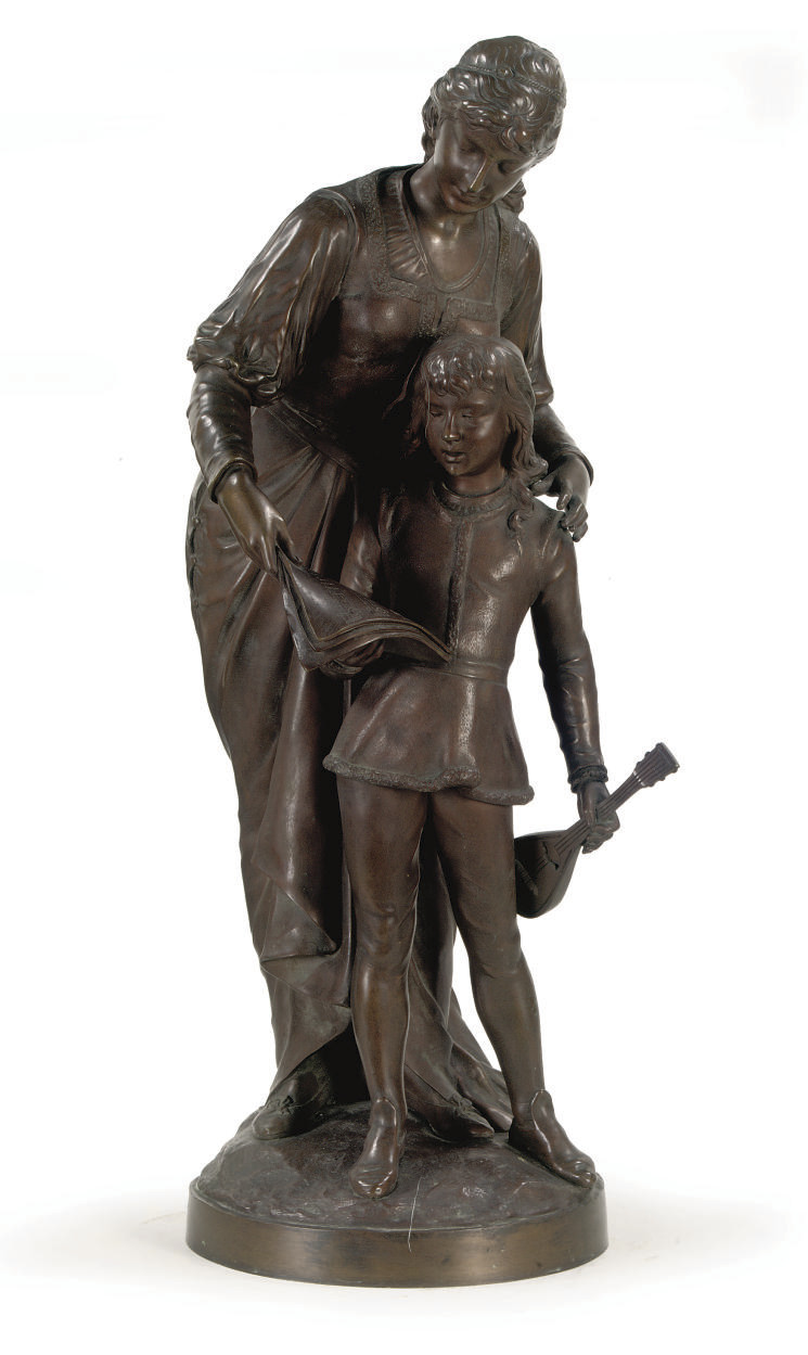 A BRONZE GROUP OF A LADY AND A BOY MAKING MUSIC