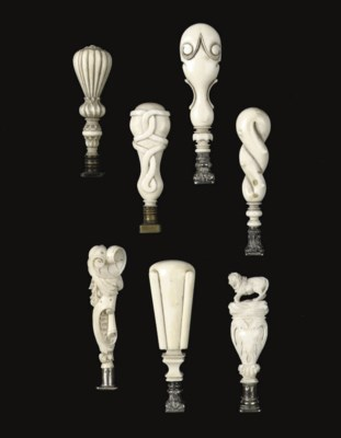 SEVEN VARIOUS CARVED IVORY SEA