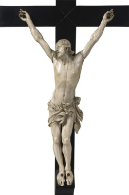 A CARVED IVORY CORPUS CHRISTI