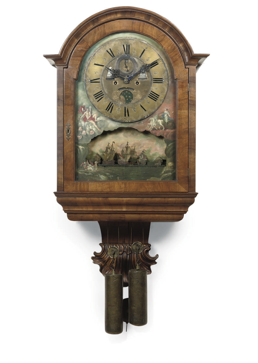 A GERMAN WALNUT HOOD CLOCK WIT