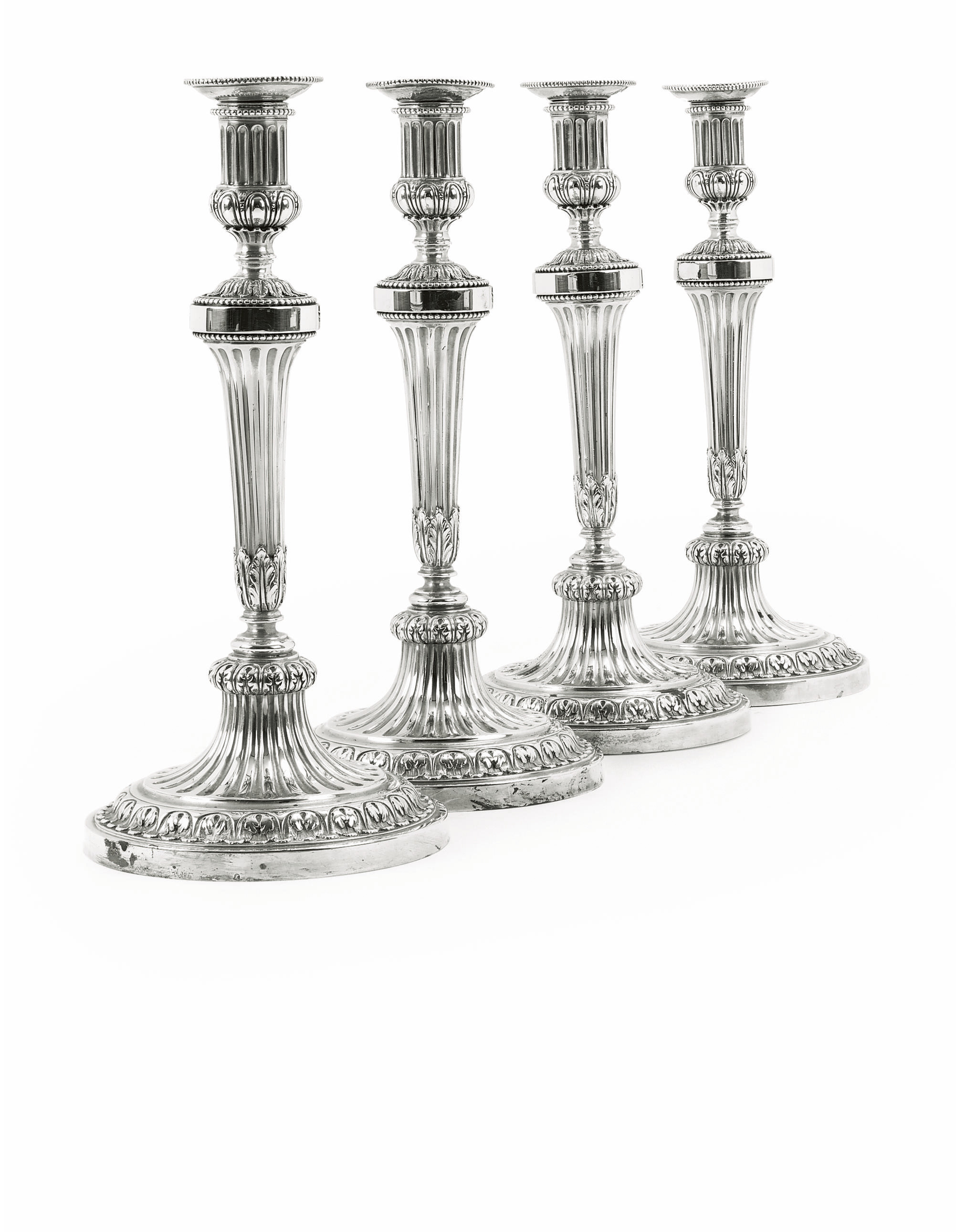 A SET OF FOUR DUTCH CANDLESTIC