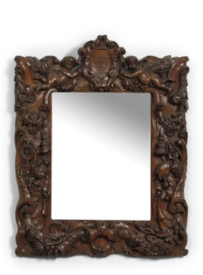 A DUTCH CARVED WALNUT MIRROR