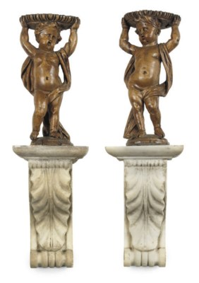 A PAIR OF CARVED LIMEWOOD CHER