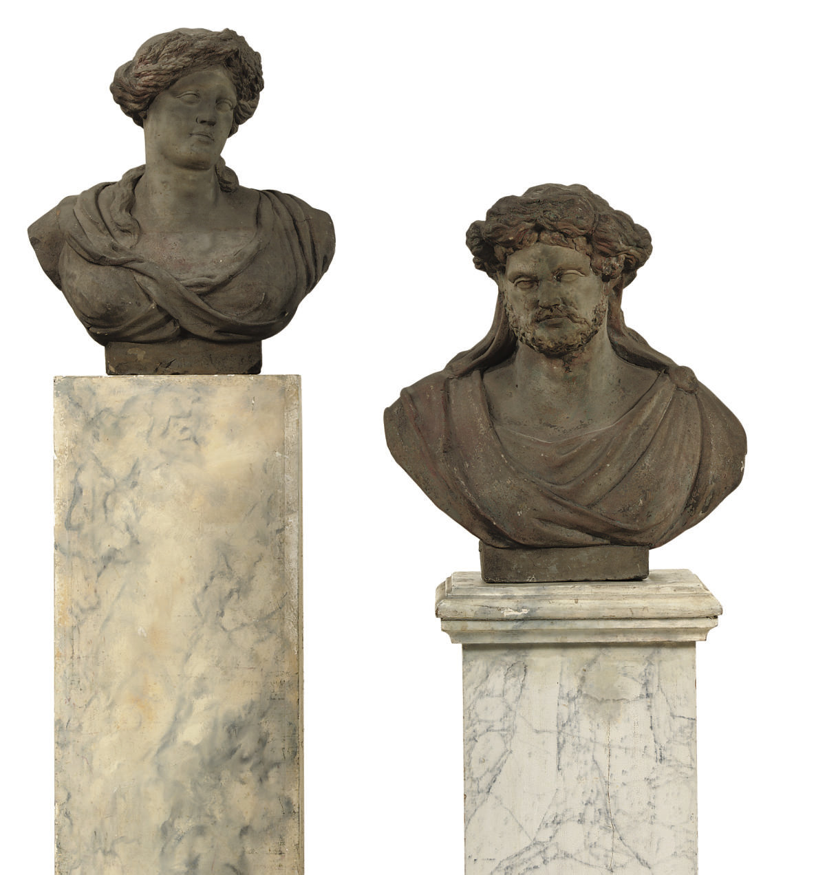 A PAIR OF CARVED STONE BUSTS O