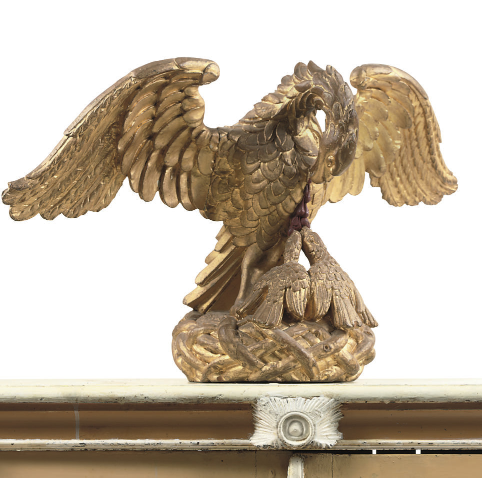 A CARVED GILTWOOD SCULPTURE OF