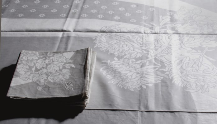 A DAMASK LINEN TABLECLOTH AND