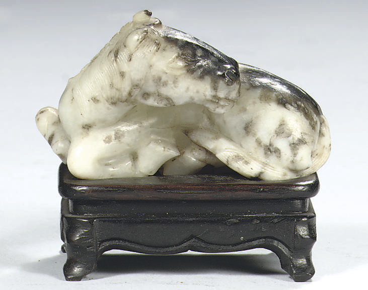 A Chinese jade figure of a hor