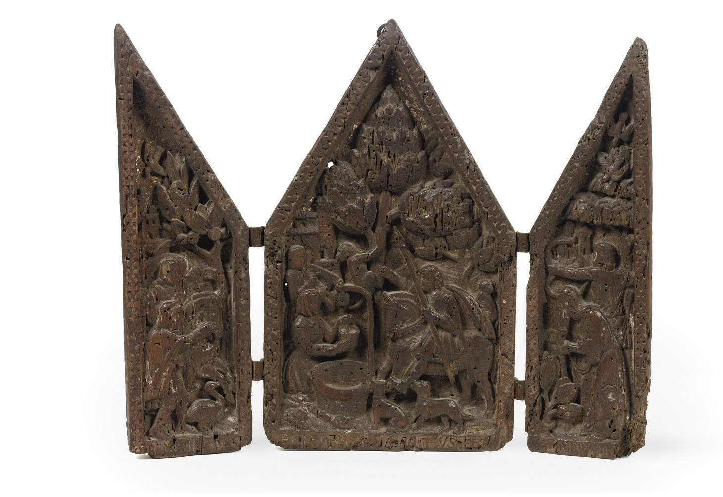 A CARVED WOOD RELIEF TRYPTYCH