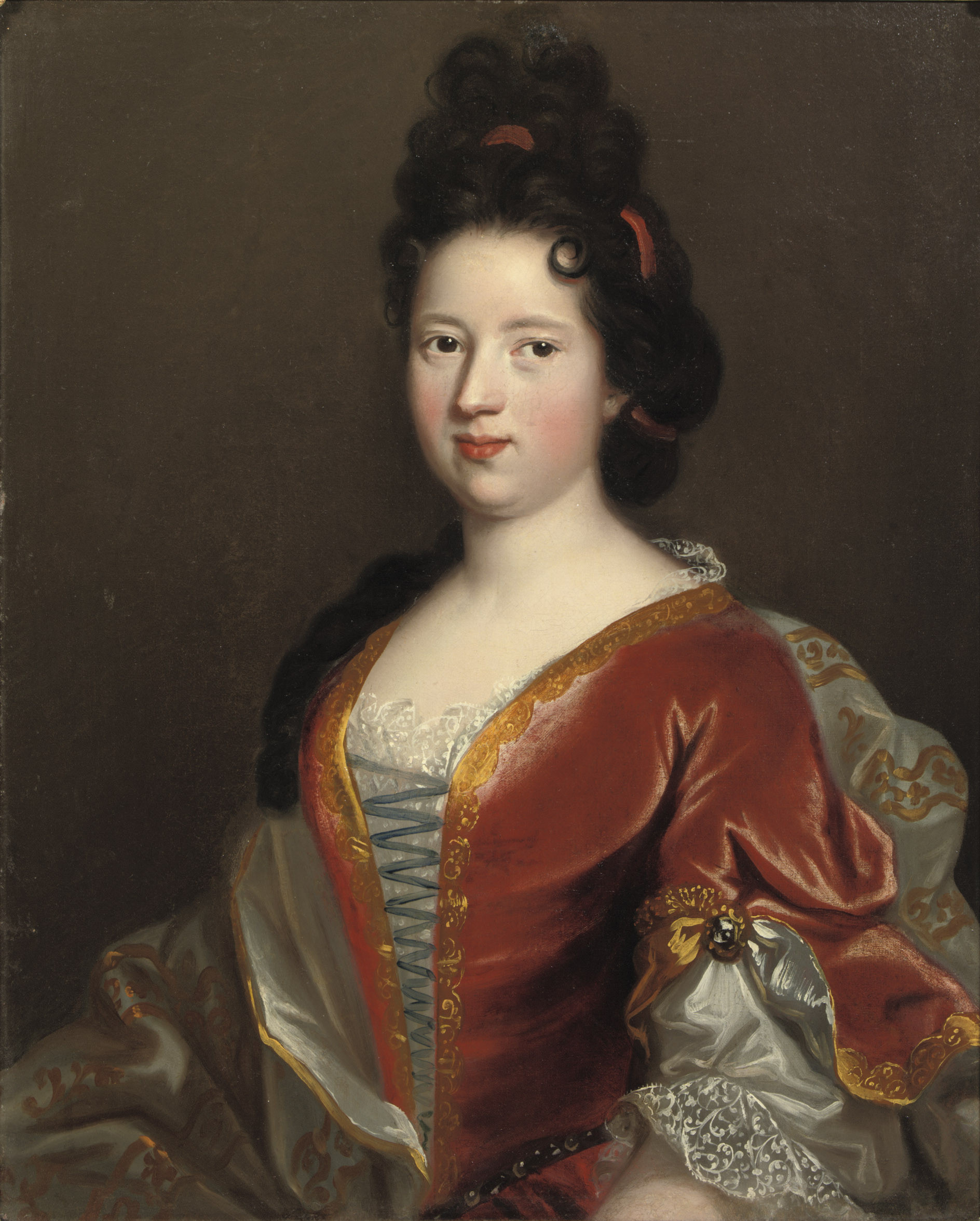 Portrait of a young lady, half-length, in a gold embroidered red velvet dress and white chemise