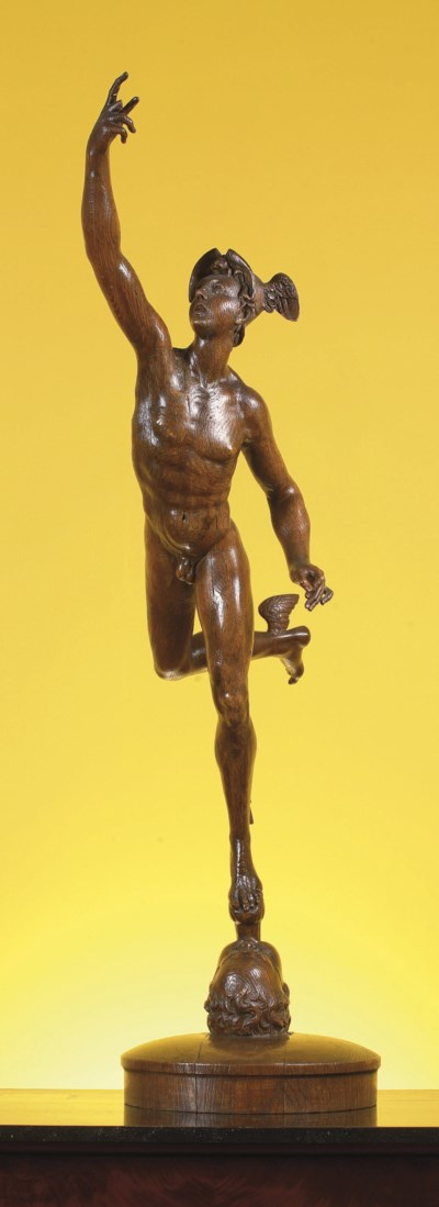 A CARVED OAK FIGURE OF MERCURY